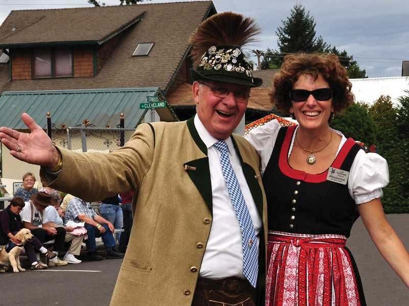 by: KAY SCHACHER - Jerry Lauzon and Liz Schmidt, Oktoberfest directors, enjoy last year's festivities.