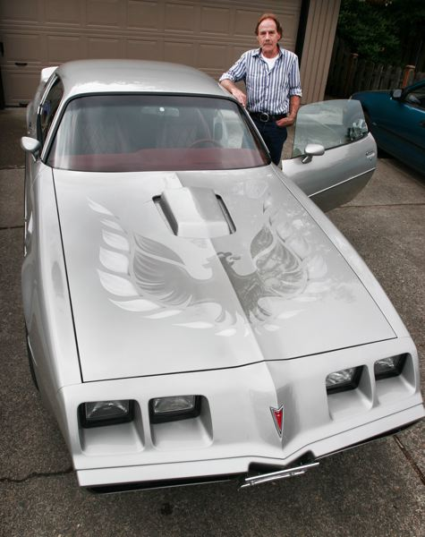 by: OUTLOOK PHOTO: JIM CLARK - Kelly Lewis of Troutdale has driven his Pontiac Trans Am every day since he bought it new in 1980 from Jim Weston Pontiac-GMC in Gresham. He keeps it in prime condition.