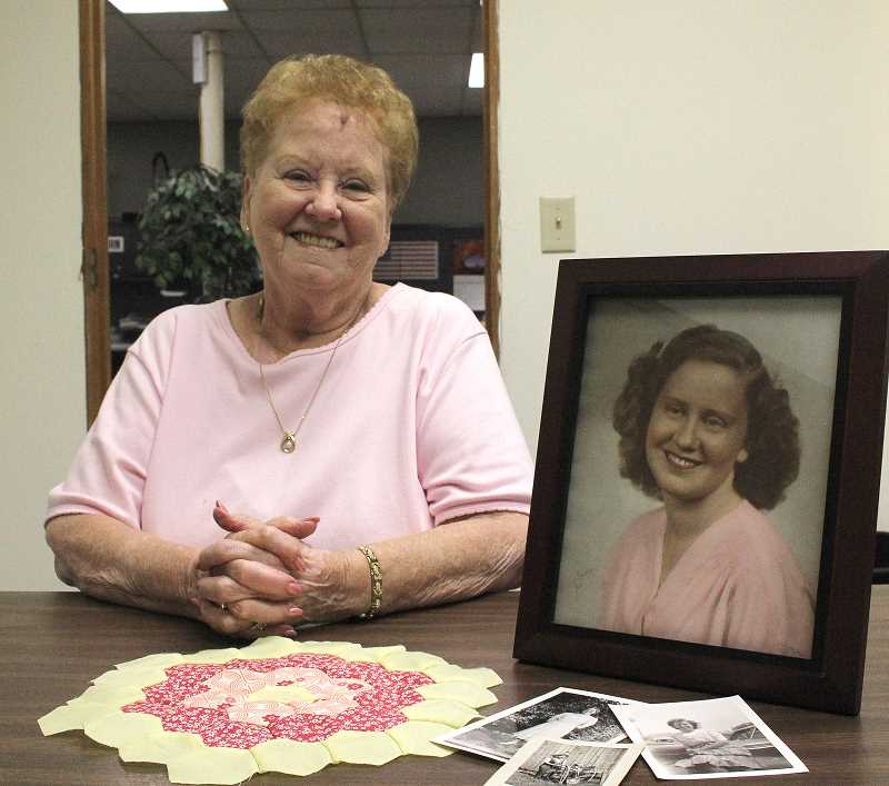by: LINDSAY KEEFER - Phyllis Cochran, a Woodburn resident turning 90 on Thursday, poses with a 70-year-old photo of herself.