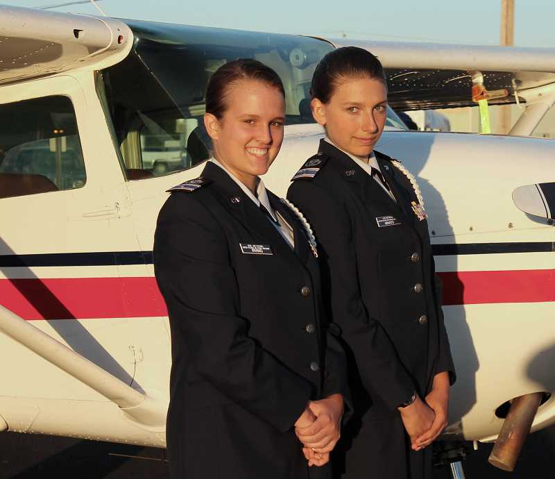 by: SPOKESMAN PHOTO: KATE HOOTS - Elizabeth Irving of Tigard, left, and West Linn's Kyla Minato are both cadet second lieutenants in the Civil Air Patrol's Aurora Composite Squadron.