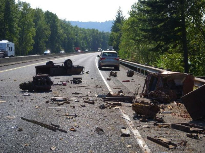by: CONTRIBUTED PHOTO - Metal debris spilled from the trailer of a truck that crashed in the Gorge Monday afternoon.