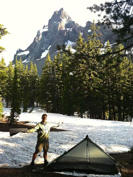 by: CONTRIBUTED PHOTO: BOB WELCH - Bob Welch stands on the Pacific Crest Trail near Thielsen Creek, within sight of Mount Thielsen, which is just east of Diamond Lake in the Umpqua National Forest. At nearly 7,000 feet elevation, its no wonder theres snow still on the ground in late July.