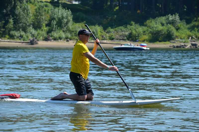 by: KEVIN KING - Everyone has their own style of paddling, including Steve Gatt. The paddleboard race featured a fantastic finish.