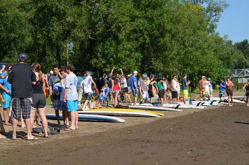 by: KEVIN KING - Crowds of happy spectators swarmed the beach on the Willamette River to watch Stand Up to NF. They were rewarded with an incredibly exciting finish.