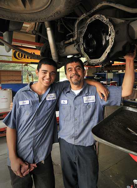Photo Credit: TIDINGS PHOTO: VERN UYETAKE - Isa Flores' son, Isa Flores Jr., works part time alongside his father at Isa's Auto Service - which will soon move to Oregon City.