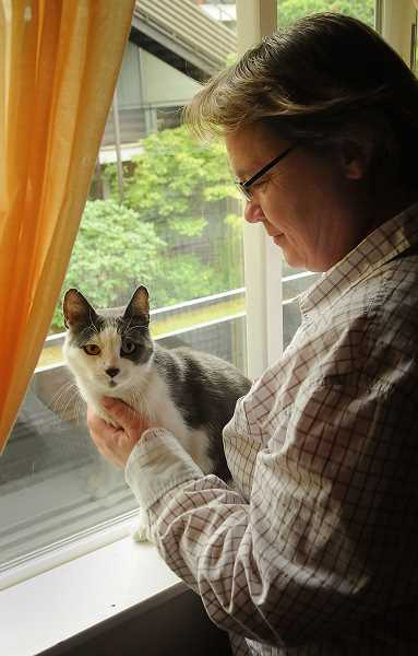 by: VERN UYETAKE - Trish Watson is now making up for a lost year in the life of her cat, Jack.