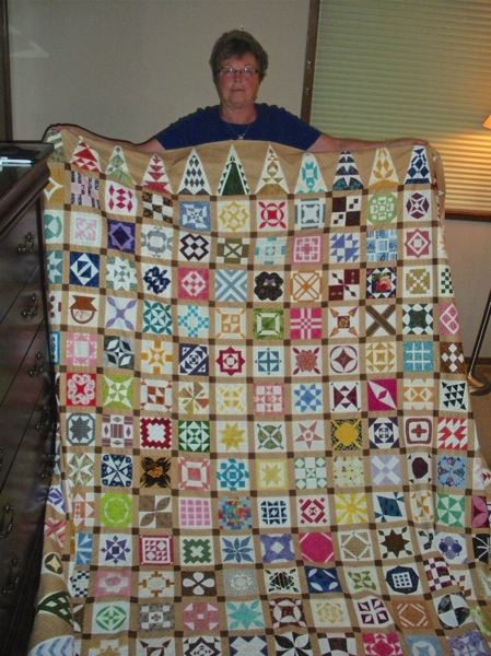 by: POST PHOTO: JIM HART - Showing a quilt that is still unfinished, quilter Jean Ludeman of Welches has copied a historic quilt designed around the time of the Civil War