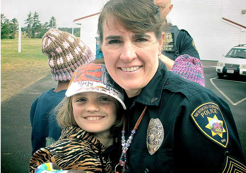 by: SUBMITTED - To protect, serve and make camp awesome - Sgt. Gwen Johns, also known as 'Pelé,' poses with one of her campers at the conclusion of this year's Camp Rosenbaum, which was held the last week of July at the Oregon National Guard's Camp Rilea near Warrenton.