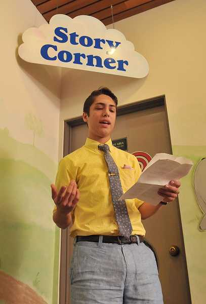 by: REVIEW PHOTO: VERN UYETAKE - Lake Oswego High School graduate Brennan Heller read three poems at the poetry slam.