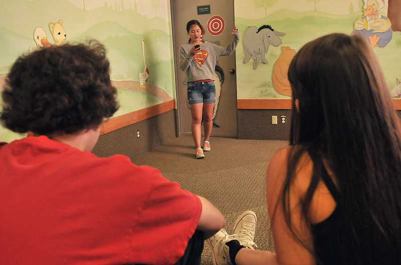 by: REVIEW PHOTO: VERN UYETAKE - Poetry slam organizer Casey Lum shares her work.