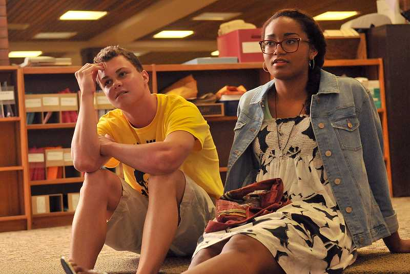 by: REVIEW PHOTO: VERN UYETAKE - Recent Lake Oswego High School graduates Luke Marshall and Alena Imamura listen to teen poets orate their written works.