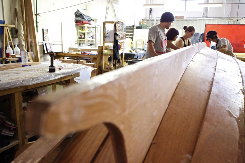 by: TRIBUNE PHOTO: JAIME VALDEZ - High school students learn to build boats in a new approach by nonprofit Wind & Oar Boat School for at-risk youth.