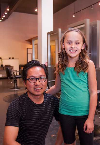 by: PAMPLIN MEDIA GROUP: JOSH KULLA - Brooklynn Oldroyd is all smiles after receiving a haircut from GiGi owner Johnny Hoang on Aug. 4.