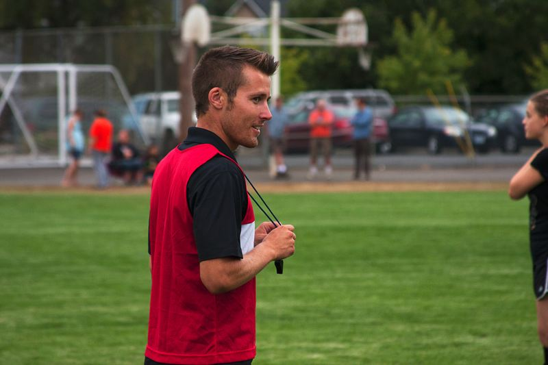 by: JOHN WILLIAM HOWARD - Nicholas Heffernan watches as subs take the field during an intersquad scrimmage between St. Helens High School and Scappoose High School on Wednesday evening.