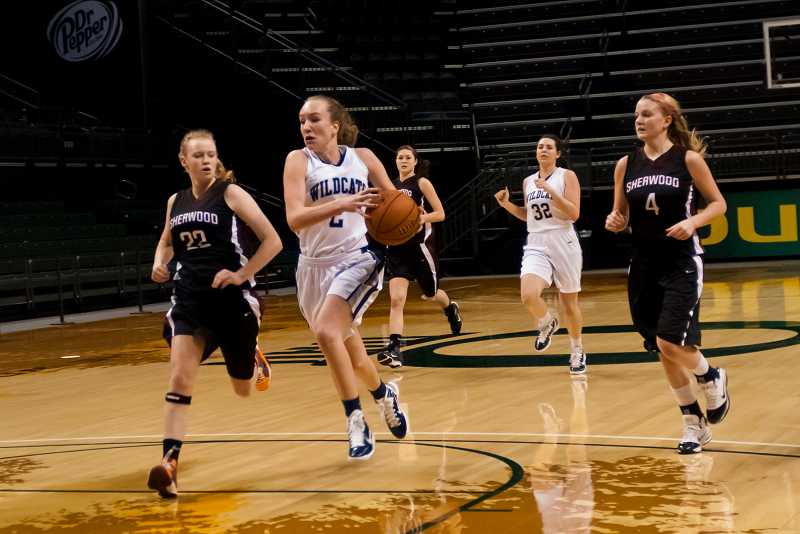 by: GREG ARTMAN - Emily Dungey (with ball), who transferred to Wilsonville after two years at Lakeridge, is now on the women's basketball team at Colorado State Pueblo.