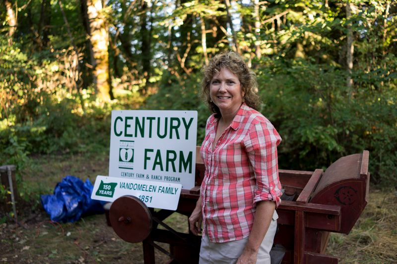 by: NEWS-TIMES PHOTO: CHASE ALLGOOD - Vanessa VanDomelen stands next to her familys brand new Century Farm & Ranch sign. VanDomelen still farms the land thats been in her family for about 150 years.