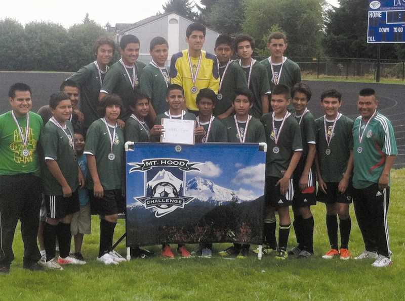 by: PHOTO COURTESY OF JOE ISABEL - The Woodburn AFC U15 boys team, the Tigres.