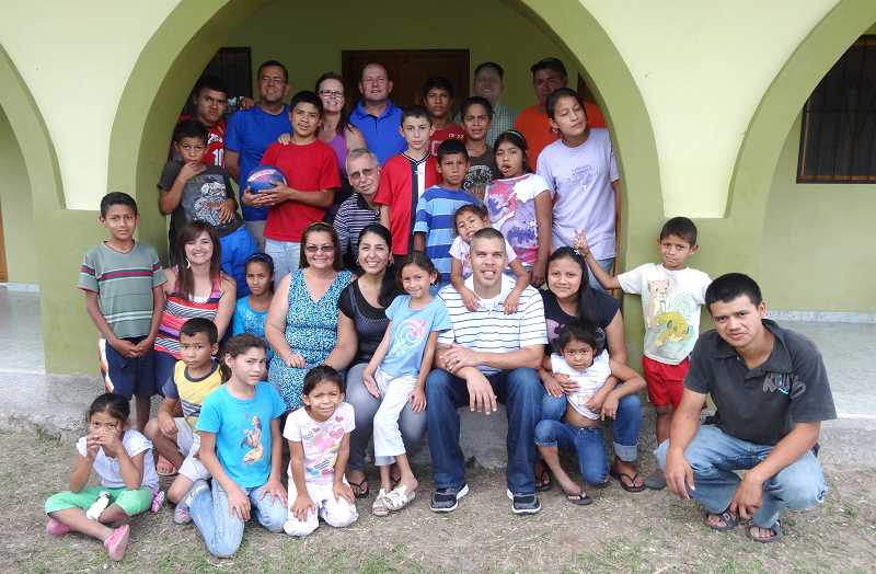 by: COURTESY OF WOODBURN FOURSQUARE CHURCH - Seven volunteers from Woodburn Foursquare Church visited Didasko Children's Home outside Tegucigalpa, Honduras this summer, building a girls dormitory and connecting with the two dozen children.
