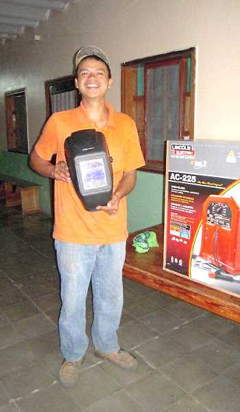 by: COURTESY OF WOODBURN FOURSQUARE CHURCH - Woodburn Foursquare Church paid for a welding machine for 20-year-old Junior, who grew up at Didasko Children's Home in Honduras and is now going to welding school.