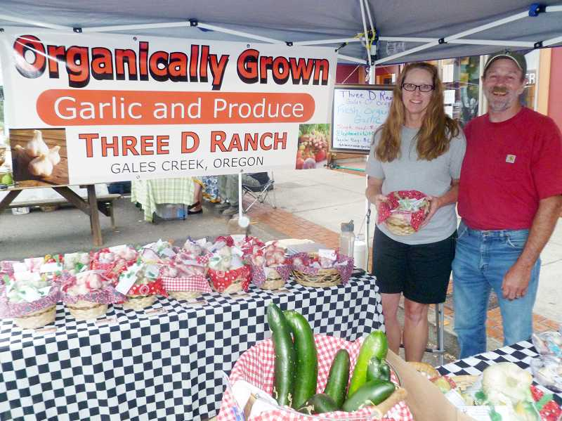 by: COURTESY PHOTO - Candii and Gordon Dana of Gales Creek use organically certified methods to cultivate garlic and other veggies to sell at the Forest Grove Farmers Market.