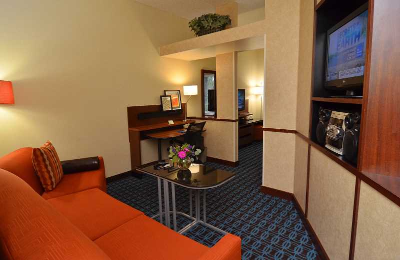 The executive studio suite includes a seating area separate from the bedroom.