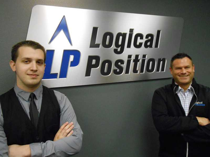 by: REVIEW PHOTO: CLIFF NEWELL - Tyler Conlee, left, and Tony Palazzo are the team responsible for the introduction of Logical Positions innovative moble application.