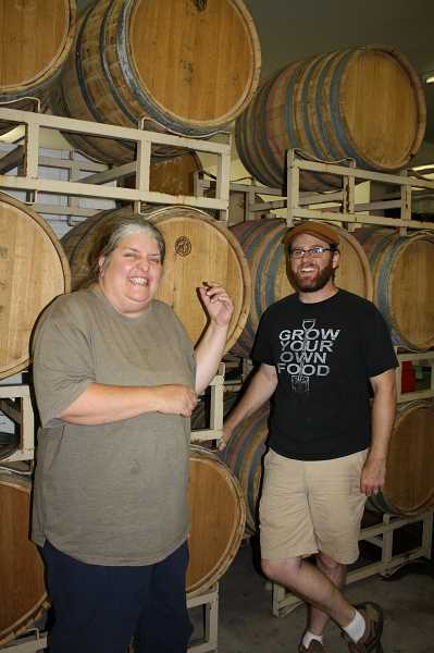 by: POST PHOTO: NEIL ZAWICKI - Buddha Kat Winery owner Lorie Dilley laughs with Josh Rude, her head winemaker. The company will celebrate its first aniversary Friday.
