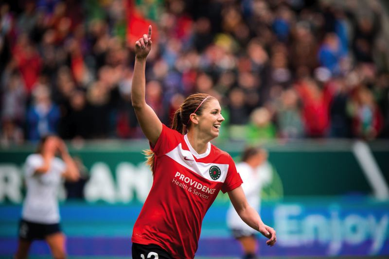 by: TRIBUNE FILE PHOTO: CHRISTOPHER ONSTOTT - Portland Thorns FC standout Alex Morgan celebrates her goal against Seattle in the season opener. Morgan hopes to overcome an injury in time for Saturdays playoff game at FC Kansas City.