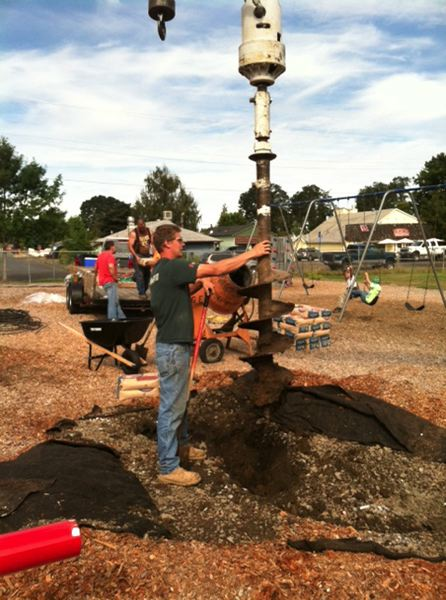 by: JENNY DURAND - Reliance Connects dug holes to install the structure at Clackamas River Elementary.