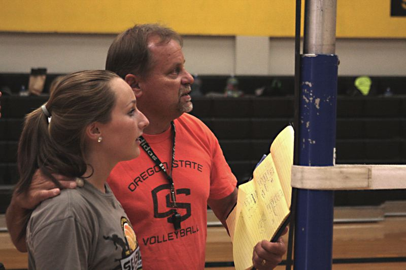 by: JOHN WILLIAM HOWARD - Tom Ray instructs a player during tryouts. Ray, who is in his 13th season as the head of the volleyball program, made final cuts on Thursday.