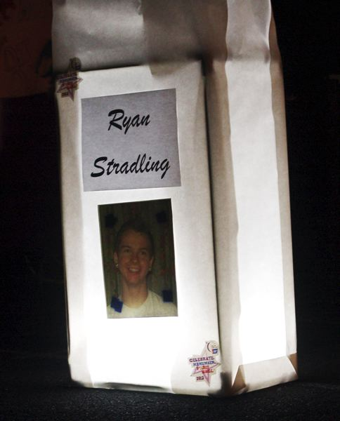 by: COURTESY PHOTO: MARK STRADLING - The special 10 p.m. luminary ceremony at Beavertons Relay for Life last Saturday included a giant luminaria in honor of Ryan Stradling and clips of Ryans trio performing last summer, about a month before he began complaining of migraines.