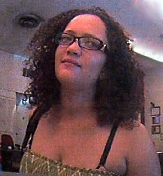 by: CONTRIBUTED PHOTO - Police say this woman is associated with the credit card thefts affecting Sandy area residents.