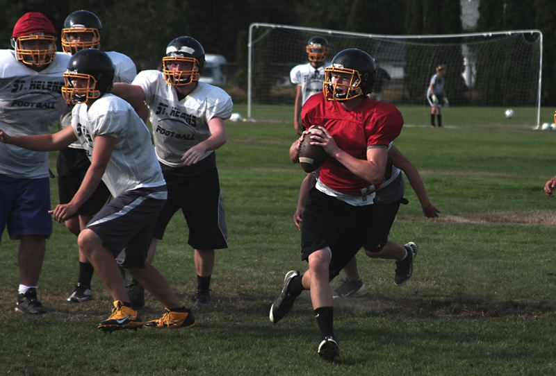by: JOHN WILLIAM HOWARD - Quarterback Gage Bumgardner rolls with the ball during 11 on 11 drills at practice on Wednesday. Bumgardner showed his running ability on several plays, as well as good accuracy when throwing the ball.