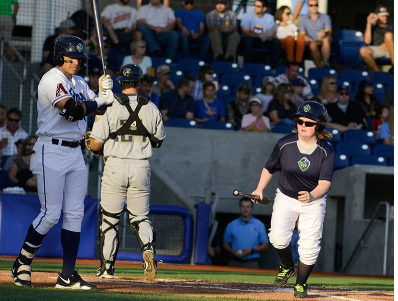 by: HILLSBORO TRIBUNE PHOTO: CHASE ALLGOOD - Madison Heldt retrieves a bat from home plate during a Hillsboro Hops game. Heldt has a rare medical condition called lipoprotein lipase deficiency, which requires lifelong treatment.