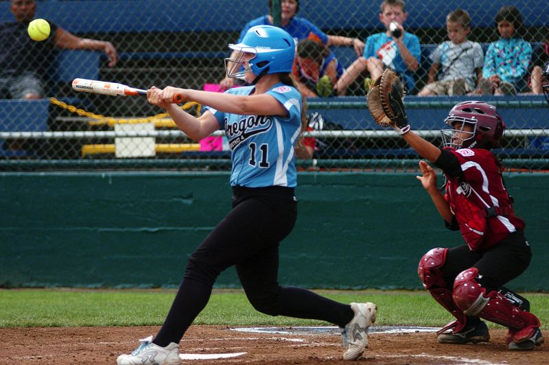 by: DAN BROOD - 'SMACK -- Tualatin City's Noelle Sawyer gets her bat on the ball during last week's game at the Little League Softball World Series.