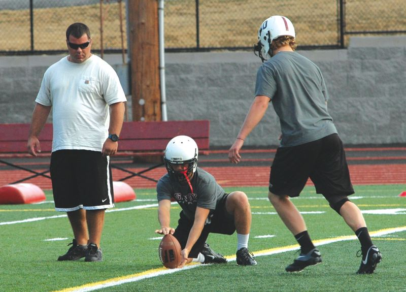 by: SANDY POST: PARKER LEE - Sandy players go through kicking drills during practice Monday.