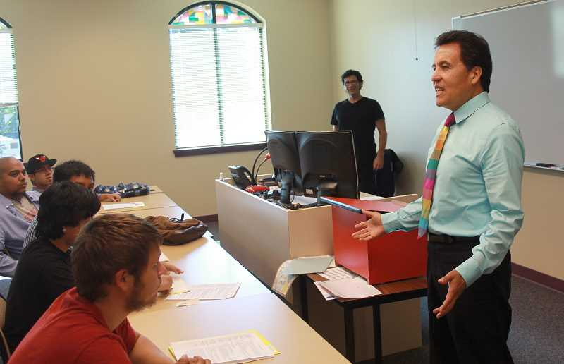 by: JEFF MCDONALD  - Jeff McDonald | Woodburn Independent Elias Villegas, dean of Chemeketa Community College in Woodburn, tells a group of first-year writing students the importance of being role models for the rest of their family. Villegas became dean in 2005.