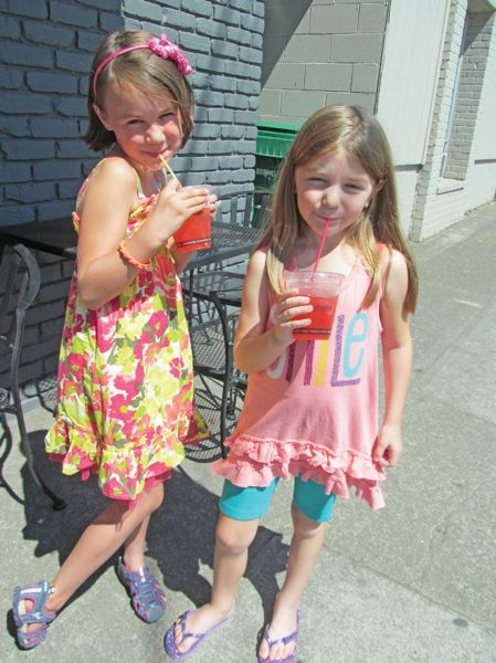 by: PHOTO BY ELLEN SPITALERI - Ava Schreffler, left, and Addie May Pinson taste the fruits of their labors as they sip the raspberry lemonade they just made.