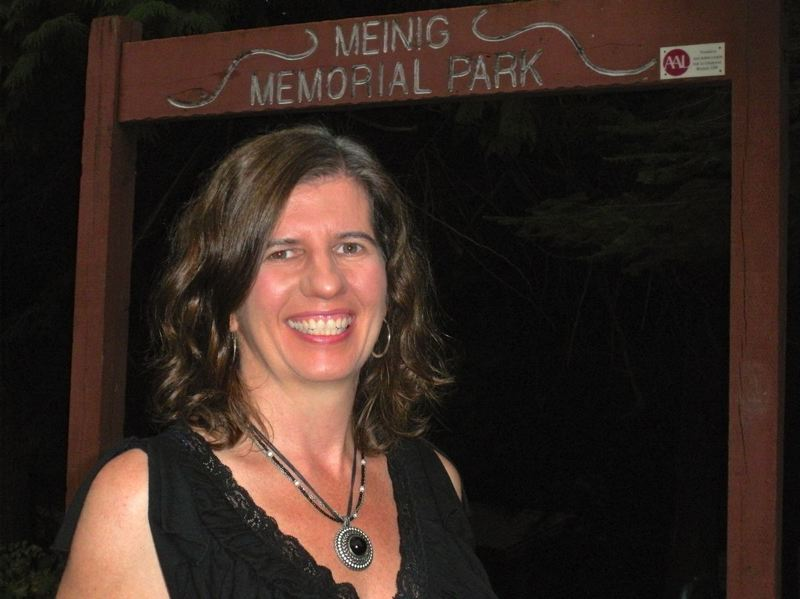 by: POST PHOTO: JIM HART - Katie Murphy stands in front of the entrance to Meinig Memorial Park, where she has organized concerts and movie showings during each summer for the past 10 years.