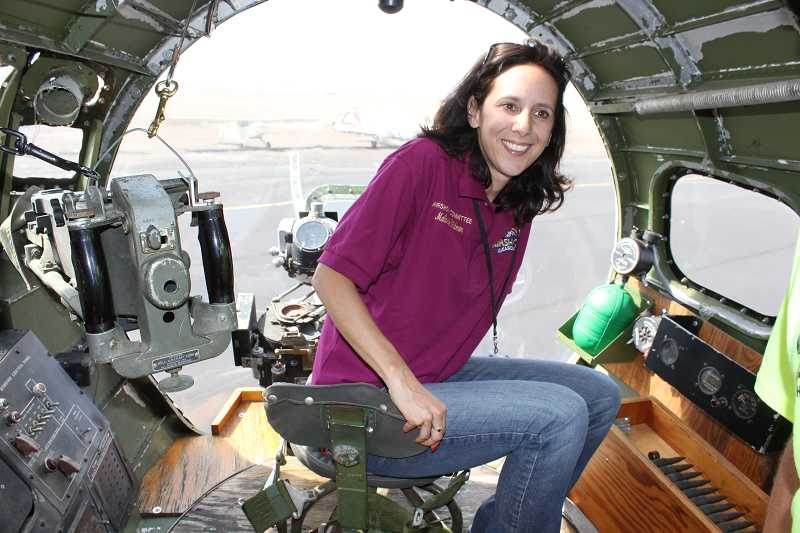 by: SUSAN MATHENY/MADRAS PIONEER - Madras Mayor Melanie Widmer sits at the 'chin turret' in the nose cone of the plane, prior to takeoff.