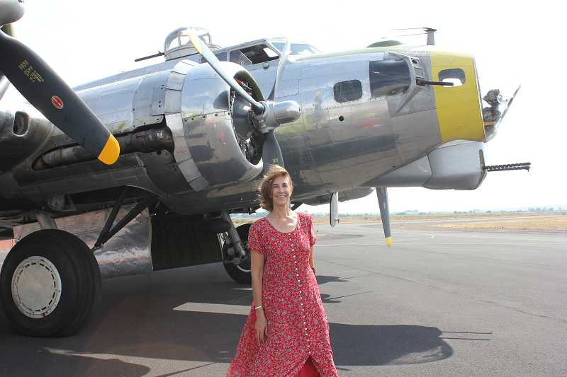 by: PHOTO BY MELANIE WIDMER - Reporter Susan Matheny in front of the WWII B-17 before takeoff.