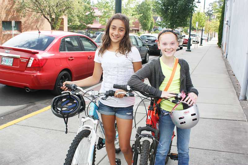 by: NEWS-TIMES PHOTO: DOUG BURKHARDT - Hailey Peterson (left) and Makayla Sullivan, both 12, wandered into the News-Times office Monday asking where they could pick up GroveLink. They were tired from riding around town and hoped to catch a ride back to Forest Gale Heights. They and other Forest Grove residents are invited to a grand opening ceremony for GroveLink at 12 noon Tuesday, Sept. 3, in Lincoln Park, off Main Street between 27th and 28th avenues.