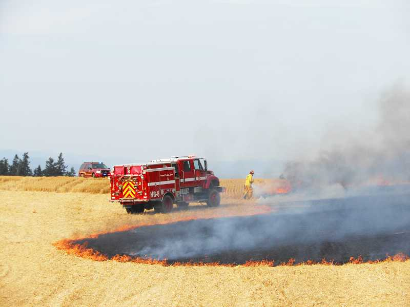 by: COURTESY PHOTO: CORNELIUS FIRE DEPARTMENT - Six brush rigs and 24 firefighters from four districts came put out a Cornelius field fire last week before it spread any farther.