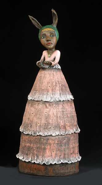 Innocence Sharpens Her Claws by Jacqueline Hurlbert, made of ceramic, stands 30 inches tall.