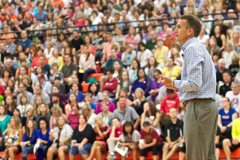 by: TIMES PHOTO: JAIME VALDEZ - Beaverton School District Superintendent Jeff Rose welcomes half of the teachers in the school district during a presentation Tuesday morning in the Beaverton High Schoo gymnasium.
