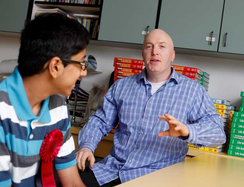 by: TIMES PHOTO: JONATHAN HOUSE - Stoller Middle School science teacher Todd Freiboth talks about the impressive research that Aditya Jain and other  students are acheving at such a young age.
