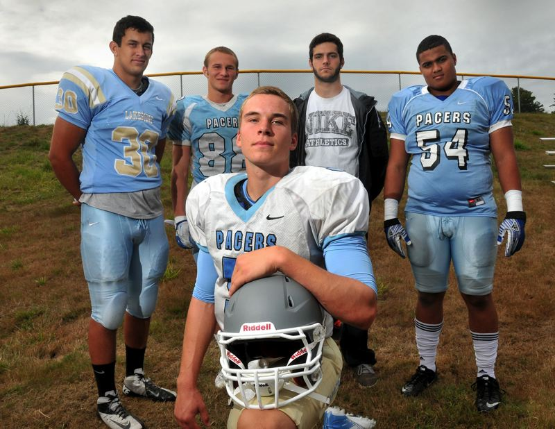 by: VERN UYETAKE - From left: Chase Marshall, Joel Schwarz, Eric Dungey, JR McLaughlin and Massen Newton figure to be leaders and key contributors for the 2013 Lakeridge football team. The Pacers hope to ramp up the defense this season while continuing to be a high-powered offensive threat.