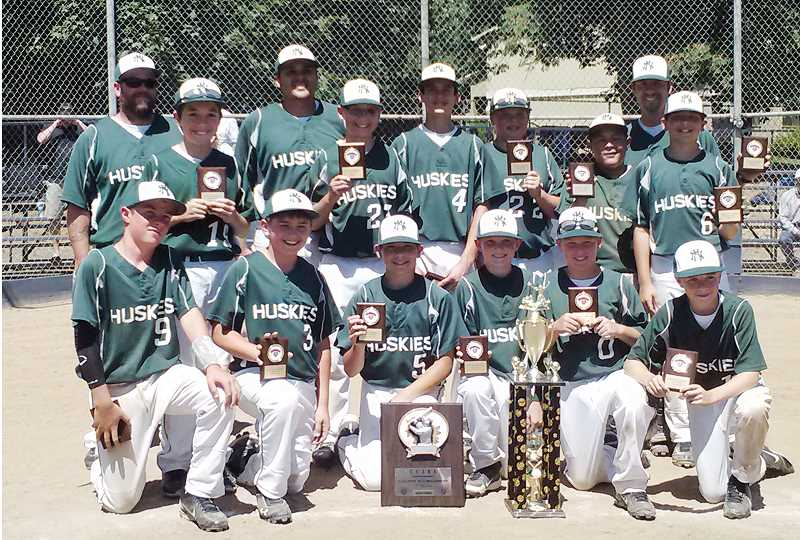 by: PHOTO COURTESY OF ERIK HENRY - North Marion PRYDE's Junior Federal baseball team presents their placards and trophy after winning the county championship in July.