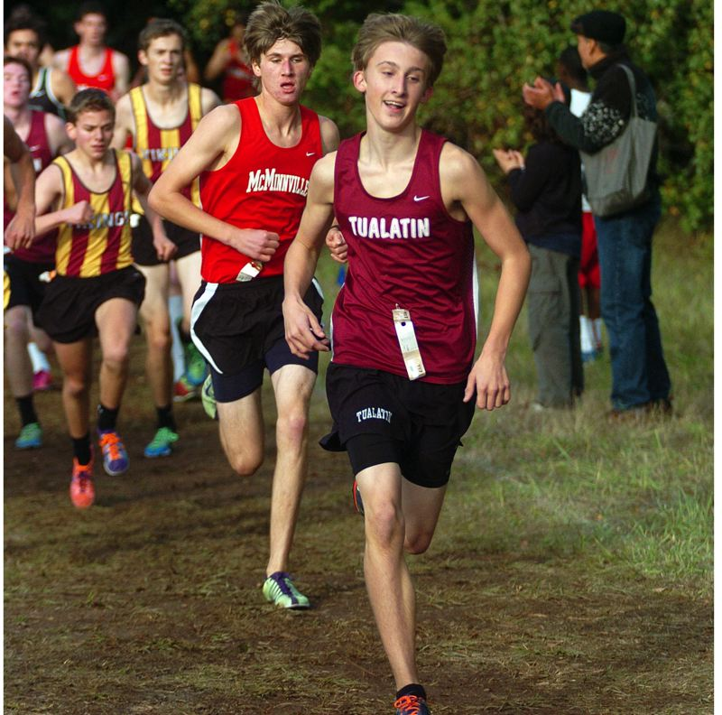 by: DAN BROOD - BACK AND RUNNING STRONG -- Matthew Lovos, shown her at last year's Pacific Conference district meet, is back for his junior year at Tualatin. Lovos raced to second place at last year's district event.