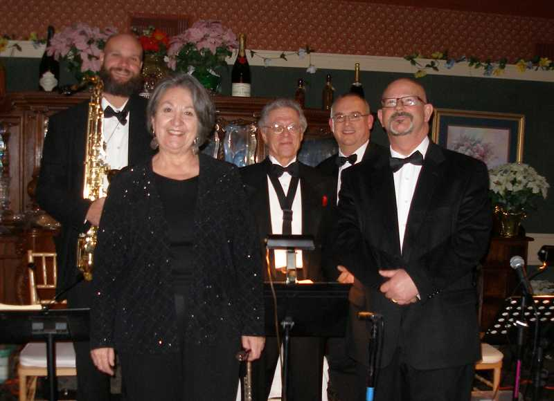 by: COURTESY OF SUZANNE SHORT - THEY'VE GOT RHYTHM - From left, Lee Elderton (tenor sax), Suzanne Short (keyboards) Bob Masca (alto sax), Jim Miller (trombone) and  Brad Davis (trumpet) became the Swing Sensation, which plays big band music.